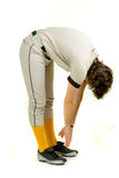 Baseball Player. A young male baseball player stretching stock images