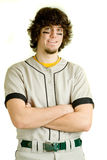 Baseball Player. A young male baseball player standing royalty free stock photo