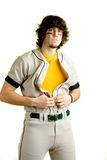 Baseball Player. A young male baseball player standing royalty free stock photography