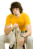Baseball Player. A young male baseball player sitting on a stool stock photos