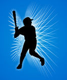 Baseball player. Silhouette of a baseball player on blue Royalty Free Stock Image