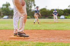 Baseball player on a base Stock Images