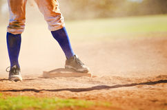 Baseball player on the base Stock Photography