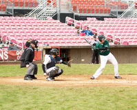 Baseball player swinging at ball..