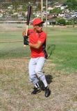 Baseball player at bat. Baseball player stands at bat, ready to swing Stock Image
