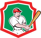 Baseball Player Batting Crest Cartoon. Illustration of an american baseball player batter hitter batting with bat set inside shield crest done in cartoon style Royalty Free Stock Photo