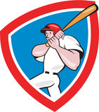 Baseball Player Batting Crest Red Cartoon. Illustration of an american baseball player batter hitter batting with bat done in cartoon style set inside red crest Royalty Free Stock Photo