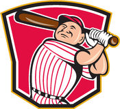 Baseball Player Batting Shield Cartoon. Illustration of a american baseball player batter hitter batting with bat inside crest shield shape done in cartoon style Royalty Free Stock Image