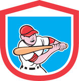 Baseball Player Batting Shield Cartoon. Illustration of a baseball player batter hitter batting with bat done in cartoon style set inside shield crest on Royalty Free Stock Photo