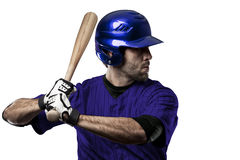 Baseball Player. With a blue uniform on a white background Royalty Free Stock Photo