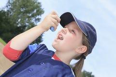 Baseball player having a asthma crisis Stock Image