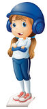 A baseball player in her blue uniform Royalty Free Stock Image