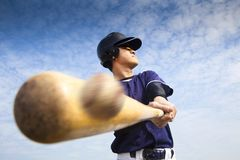 Baseball player hitting. Young baseball player hitting the ball Royalty Free Stock Image
