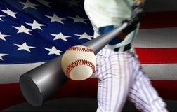 Baseball player hitting ball with American flag