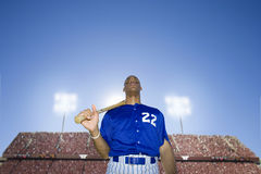 Baseball player holding bat with crowd in background Royalty Free Stock Photography