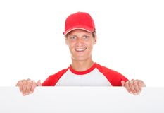 Baseball Player Holding Blank Placard royalty free stock photo