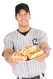 Baseball: Player Holding Plate of Hot Dogs. Isolated on white series of two man in baseball uniforms, in various poses with props Stock Images
