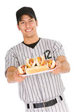 Baseball: Player Holding Plate of Hot Dogs royalty free stock images