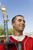 Baseball player holding trophy Royalty Free Stock Photography