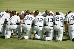 Baseball Player Kneeling on Grass Field during Daytime Stock Image