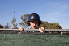 Baseball Player Peeking Over the Dug Out Royalty Free Stock Image