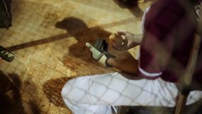 Baseball player playing with a ball inside dugout stock video footage
