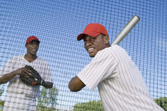 Baseball Player Preparing To Hit A Ball. Confident African American baseball batter waiting to strike the ball Stock Images