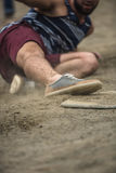 Baseball player reaching base during game on court Royalty Free Stock Photo