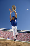 Baseball player reaching to catch baseball Stock Photo