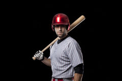 Baseball Player on a red uniform. Royalty Free Stock Photos