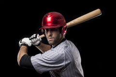 Baseball Player on a red uniform. Stock Photo