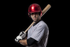 Baseball Player on a red uniform. Royalty Free Stock Photography