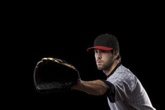 Baseball Player on a red uniform. Royalty Free Stock Images
