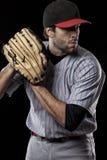 Baseball Player on a red uniform. Stock Photos
