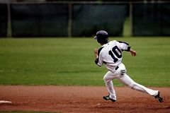 Baseball Player Running on Court Stock Images