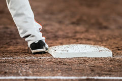 Baseball player with he's feet touching the base plate Stock Images