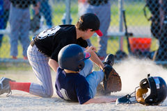 Baseball player sliding. Youth baseball game showing boy sliding into home plate Royalty Free Stock Photo