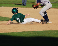 Baseball Player Sliding Into 2nd Base. Royalty Free Stock Images