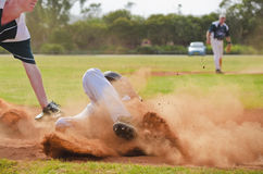 Baseball player sliding into third base Stock Images
