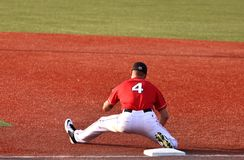 Baseball player stretches Royalty Free Stock Photography