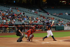 Baseball. Player strike swinging in baseball match Royalty Free Stock Photography