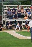 Baseball player swinging at ball Royalty Free Stock Photos