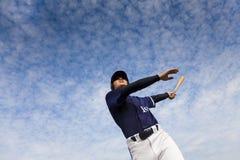 Baseball player taking a swing. Young baseball player taking a swing royalty free stock photos