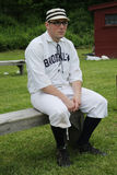 Baseball player in 19th century vintage uniform during old style base ball play Stock Image