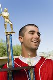 Baseball Player With Trophy Royalty Free Stock Images