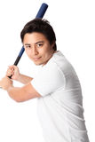 Baseball player in white t-shirt with bat. Young baseball player wearing a white t-shirt and shorts. White background Stock Images