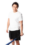 Baseball player in white t-shirt with bat. Young baseball player wearing a white t-shirt and shorts. White background Royalty Free Stock Image