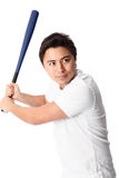Baseball player in white t-shirt with bat. Young baseball player wearing a white t-shirt and shorts. White background Stock Photography