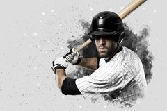 Baseball Player. With a white uniform coming out of a blast of smoke Royalty Free Stock Images