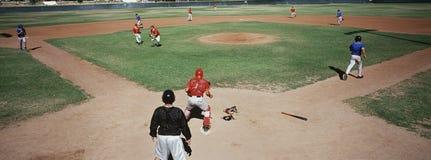 Baseball Players Playing Tournament. Baseball tournament match between two teams on field Stock Photo